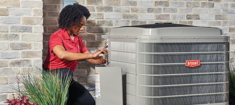 HVAC technician repairing an air conditioner