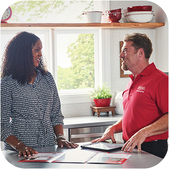 Homeowner exploring heating products with a salesperson