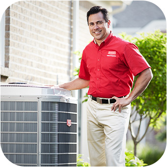 HVAC technician standing with Bryant air conditioner