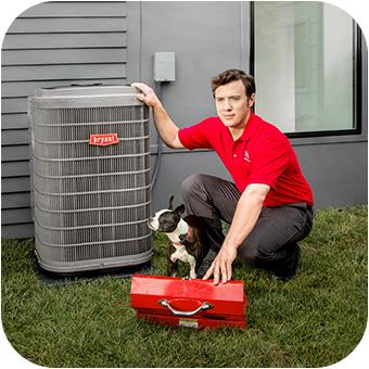 HVAC technician finishing an air conditioner repair