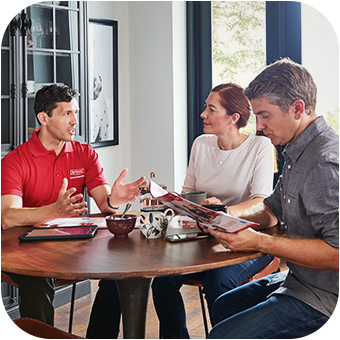 HVAC salesperson discussing boiler unit options with homeowner