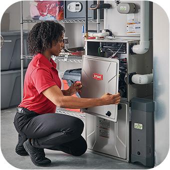 HVAC technician repairing a furnace